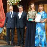 Мария Светлакова получила медаль из рук главы администрации района С.В. Герасимова